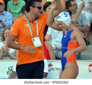 Budapest, Hungary - Jul 16, 2014. Netherland's HAVENGA Arno head coach and GENEE Amarens Dousten (NED, 5) are very happy after winning.