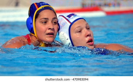 Budapest, Hungary - Jul 16, 2014. KRIMER Kseniia (RUS, 5) fighting against MIRANDA DORADO Lorena (ESP, 7). The Waterpolo European Championship was held in Alfred Hajos Swimming Centre in 2014.