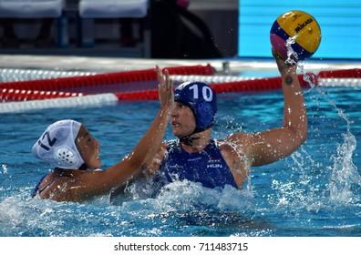 Budapest, Hungary - Jul 16, 2017. BUJKA Barbara (HUN) fights with SUZUKI Kotor (JPN) in the preliminary round. FINA Waterpolo World Championship was held in Alfred Hajos Swimming Centre in 2017.