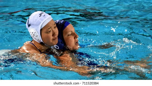 Budapest, Hungary - Jul 16, 2017. TOTH Ildiko (HUN) fights with ARIMA Yumi (JPN) in the preliminary round. FINA Waterpolo World Championship was held in Alfred Hajos Swimming Centre in 2017.