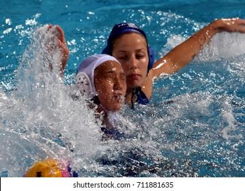 Budapest, Hungary - Jul 16, 2017.  SZUCS Gabriella (HUN) fights with SUZUKI Kotori (JPN) in the preliminary round. FINA Waterpolo World Championship was held in Alfred Hajos Swimming Centre in 2017.