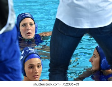 Budapest, Hungary - Jul 16, 2017. The hungarian women waterpolo team (ANTAL Dora, SZILAGYI Dorottya, CSABAI DORA) listen to the strategy from the coach (BIRO Attila) in the break.
