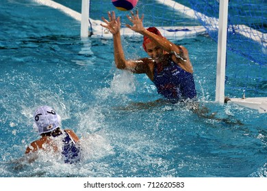 Budapest, Hungary - Jul 16, 2017. KASO Orsolya (HUN) defends shooting of YAMAMOTO Minori (JPN) in the preliminary round. FINA Waterpolo World Championship was held in Budapest in 2017.