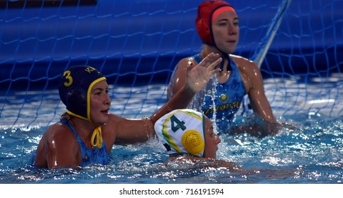 Budapest, Hungary - Jul 16, 2017. AKILBAYEVA Aizhan (KAZ) defends against HALLIGAN Bronte (AUS) in the preliminary round. FINA Waterpolo World Championship was held in Alfred Hajos Swimming Centre.