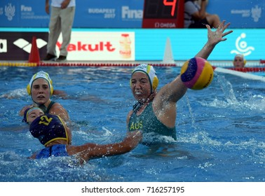 Budapest, Hungary - Jul 16, 2017. ARANCINI Zoe (AUS) defends shoot of MUSSAROVA Assem (KAZ) the preliminary round. FINA Waterpolo World Championship was held in Alfred Hajos Swimming Centre in 2017.