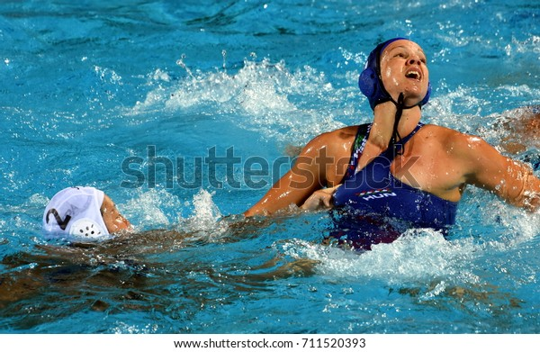 Budapest, Hungary - Jul 16, 2017. TOTH Ildiko (HUN) fights with ARIMA Yumi (JPN) in the preliminary round. FINA Waterpolo World Championship was held in Alfred Hajos Swimming Centre in 2017.