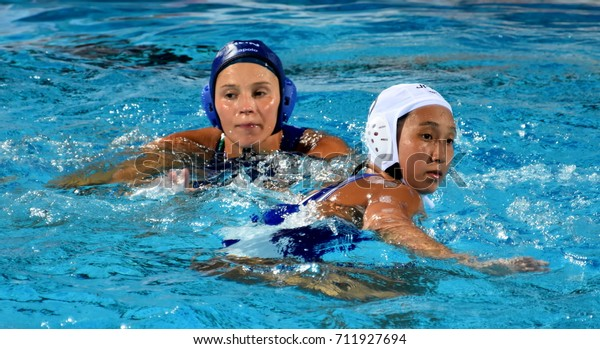 Budapest, Hungary - Jul 16, 2017. ILLES Anna (HUN) fights with SAKANOUE Chiaki  (JPN) in the preliminary round. FINA Waterpolo World Championship was held in Alfred Hajos Swimming Centre in 2017.