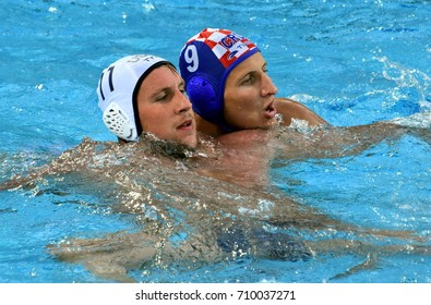 Budapest, Hungary - Jul 17, 2017. SUKNO Sandro (CRO) playing against  ROELSE Alex (USA) in the preliminary round. FINA Waterpolo World Championship was held in Alfred Hajos Swimming Centre in 2017.