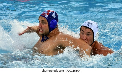 Budapest, Hungary - Jul 17, 2017. LONCAR Luka (CRO) fights with OBERT Alex (USA) in the preliminary round. FINA Waterpolo World Championship was held in Alfred Hajos Swimming Centre in 2017.