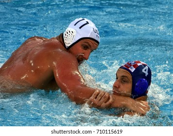 Budapest, Hungary - Jul 17, 2017. LONCAR Luka (CRO) fights with ROELSE Alex (USA) in the preliminary round. FINA Waterpolo World Championship was held in Alfred Hajos Swimming Centre in 2017.