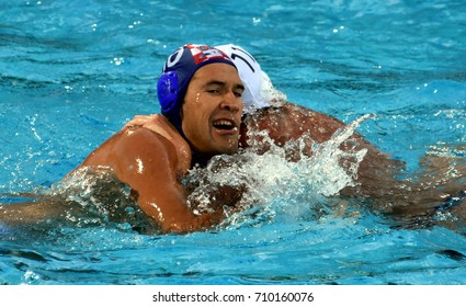 Budapest, Hungary - Jul 17, 2017. KRAPIC Ivan (CRO) playing against ROELSE Alex (USA) in the preliminary round. FINA Waterpolo World Championship was held in Alfred Hajos Swimming Centre in 2017.