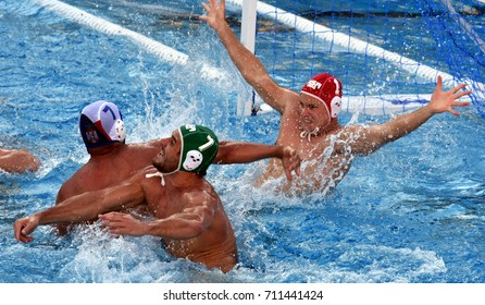 Budapest, Hungary - Jul 17, 2017. LEWIS Julian (RSA) goalkeeper and RABIE Lood (RSA) defend against UBOVIC Nemanja (SRB) in the preliminary round. FINA Waterpolo World Championship 2017.