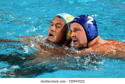 Budapest, Hungary - Jul 17, 2017. TÖRÖK Bela, hungarian waterpolo player (in blue) fights with KAYES Joe (AUS). FINA Waterpolo World Championship was held in Alfred Hajos Swimming Centre in 2017.