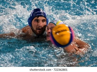 Budapest, Hungary - Jul 17, 2017. MEZEI Tamas (HUN) fights with GILCHRIST Jarrod   (AUS). FINA Waterpolo World Championship was held in Alfred Hajos Swimming Centre in 2017.