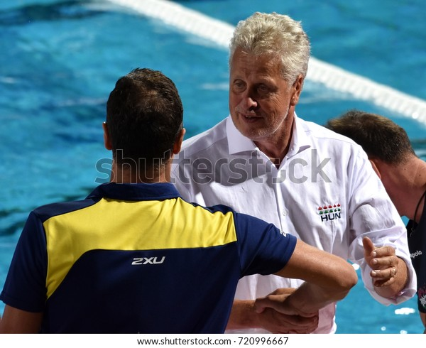 Budapest, Hungary - Jul 17, 2017. FATOVIC Elvis, head coach of Australia Men Waterpolo team congratulates to GERENDAS Gyorgy, second trainer of the hungarian team. FINA Waterpolo World Championship.