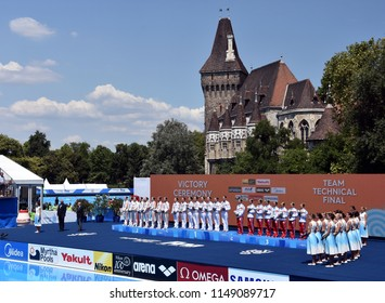 Budapest, Hungary - Jul 18, 2017. Synchronized swimming teams (Japan, China and the winner Russia) at the Victory Ceremony of Team Technical. FINA Synchro Swimming World Championship in Varosliget.