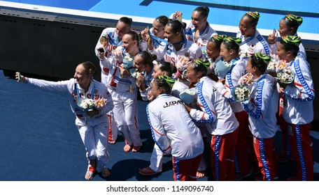 Budapest, Hungary - Jul 18, 2017. Synchronized swimming teams (Japan, China and Russia) taking selfie after the Victory Ceremony of Team Technical. FINA Synchro Swimming World Championship