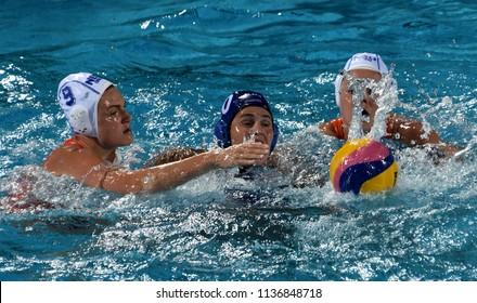 Budapest, Hungary - Jul 20, 2017. BUJKA Barbara (HUN) fights against MEGENS Maud (NED) and SEVENICH Vivian (NED) in the preliminary round. FINA Waterpolo World Championship was held in Budapest.