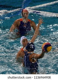 Budapest, Hungary - Jul 20, 2017.  van der SLOOT Sabrina (NED) and WILLEMSZ Debby (NED) goalkeeper defend against GURISATTI Greta (HUN) in the preliminary round of FINA Waterpolo World Championship.