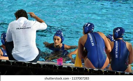Budapest, Hungary - Jul 20, 2017. The hungarian women waterpolo team (SZILAGYI Dorottya,  CSABAI Dora,  CZIGANY Dora) listen to the strategy from the coach (BIRO Attila) in the break.