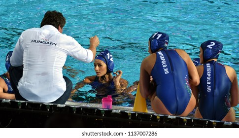 Budapest, Hungary - Jul 20, 2017. The hungarian women waterpolo team (SZILAGYI Dorottya,  CSABAI Dora,  CZIGANY Dora) listen to the strategy from the coach (BIRO Attila) in the break.
