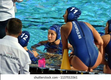 Budapest, Hungary - Jul 20, 2017. The hungarian women waterpolo team (SZILAGYI Dorottya,  CSABAI Dora,  SZUCS Gabriella, CZIGANY DORA) listen to the strategy from the coach (BIRO Attila) in the break.
