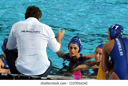 Budapest, Hungary - Jul 20, 2017. The hungarian women waterpolo team (SZILAGYI Dorottya,  CSABAI Dora,  SZUCS Gabriella) listen to the strategy from the coach (BIRO Attila) in the break.