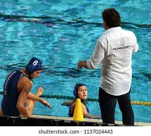 Budapest, Hungary - Jul 20, 2017. The hungarian women waterpolo team (KESZTHELYI Rita,  CZIGANY Dora) listen to the strategy from the coach (BIRO Attila) in the break.