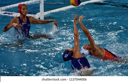 Budapest, Hungary - Jul 20, 2017. SZUCS Gabriella (HUN) and GENEE Dagmar (NED) fights for ball in the preliminary round of Waterpolo World Championship. GANGL Edina (HUN) goalkeeper in the background.