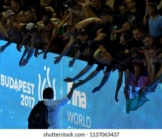 Budapest, Hungary - Jul 20, 2017. Fans welcoming BIRO Attila coach ofthe hungarian women waterpolo team after winning against Netherlands in the preliminary round of FINA Waterpolo World Championship.