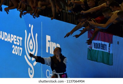 Budapest, Hungary - Jul 20, 2017. GURISATTI Greta hungarian player taking selfie with fans after winning against Netherlands in the preliminary round of FINA Waterpolo World Championship.