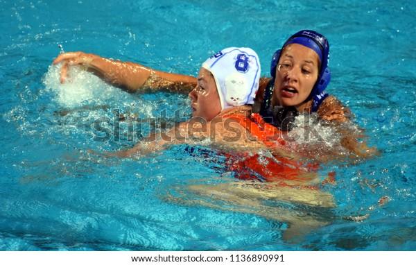 Budapest, Hungary - Jul 20, 2017. SZUCS Gabriella (HUN) fights against SEVENICH Vivian (NED) in the preliminary round. FINA Waterpolo World Championship was held in Alfred Hajos Swimming Centre.