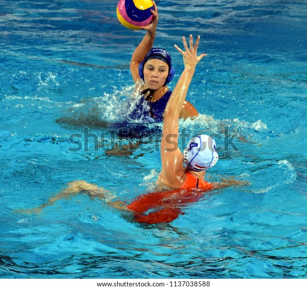 Budapest, Hungary - Jul 20, 2017. ILLES Anna (HUN) fights against van der SLOOT Sabrina (NED) for the ball in the preliminary round of FINA Waterpolo World Championship.