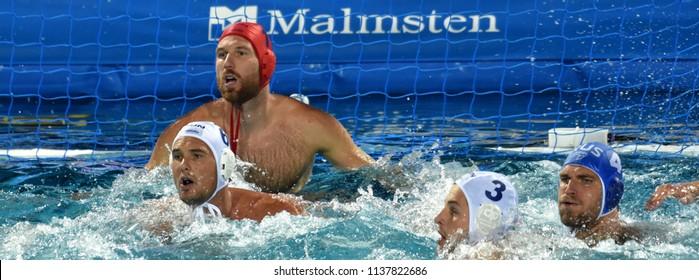 Budapest, Hungary - Jul 25, 2017. Hungarian waterpolo team (NAGY Viktor goalkeeper, MANHERCZ Krisztian, HOSNYANSZKY Norbert) defend against russian player (DEREVIANKIN Nikita).