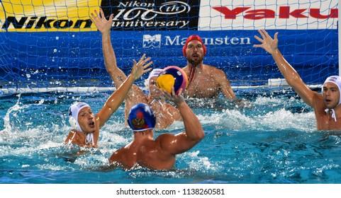 Budapest, Hungary - Jul 25, 2017. ZALANKI Gergo (HUN) defends against MERKULOV Daniil (RUS). NAGY Viktor (HUN) in the background.