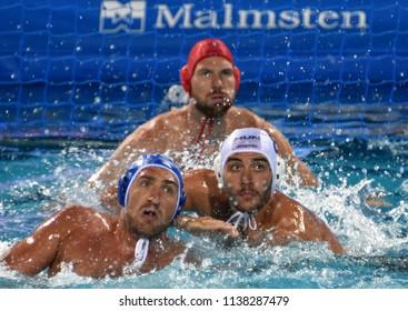 Budapest, Hungary - Jul 25, 2017. GOR-NAGY Miklos (HUN) defends against LISUNOV Sergey (RUS). NAGY Viktor (HUN) in the background. FINA Waterpolo World Championship Quarterfinal.