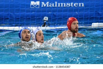 Budapest, Hungary - Jul 25, 2017. MANHERCZ Krisztian (3) hungarian waterpolo player fights against LISUNOV Sergey (11), NAGY Viktor (1) in the background. FINA Waterpolo World Championship.