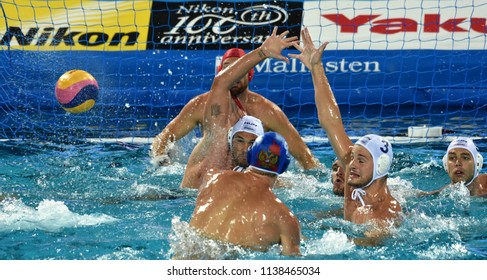 Budapest, Hungary - Jul 25, 2017. MANHERCZ Krisztian (3), HOSNYANSZKY Norbert (6), ERDELYI Balazs (9) and NAGY Viktor (1) defend against NAGAEV Ivan (8). Waterpolo World Championship.