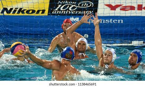 Budapest, Hungary - Jul 25, 2017. MANHERCZ Krisztian (3) and HOSNYANSZKY Norbert (6) defend against NAGAEV Ivan (8) and DEREVIANKIN Nikita (4). FINA Waterpolo World Championship Quarterfinal.