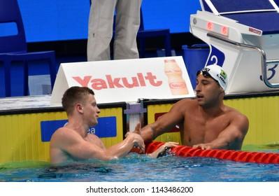 Budapest, Hungary - Jul 25, 2017. Competitive swimmer PEATY Adam (GBR) and LIMA Felipe (BRA) swimming breastroke. FINA Swimming World Championship Preliminary Heats in Duna Arena.