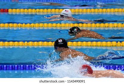Budapest, Hungary - Jul 25, 2017. Competitive swimmer KOSEKI Yasuhiro (JPN), MARTINENGHI Nicolo (ITA) and CORDES Kevin (USA) swimming breastroke. FINA Swimming World Championship Preliminary Heats.