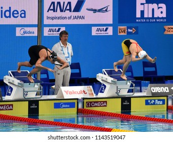 Budapest, Hungary - Jul 25, 2017. Competitive swimmer PELLEGRINI Federica (ITA) and AI Yanhan (CHN) swimming freestyle. FINA Swimming World Championship Preliminary Heats in Duna Arena.