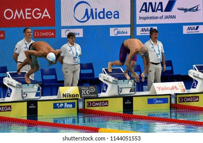 Budapest, Hungary - Jul 25, 2017. Competitive swimmer CSEH Laszlo (HUN) and LE CLOS Chad (RSA) swimming butterfly. FINA Swimming World Championship Preliminary Heats in Duna Arena.
