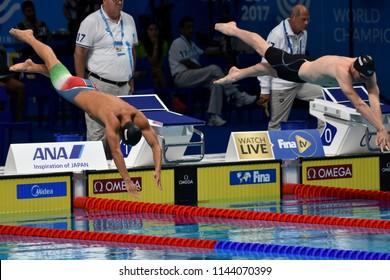 Budapest, Hungary - Jul 25, 2017. Competitive swimmer GYURTA Gergely (HUN) and AUBOCK Felix (AUT) swimming 800m freestyle. FINA Swimming World Championship Preliminary Heats in Duna Arena.