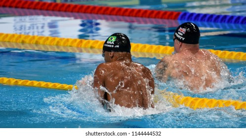 Budapest, Hungary - Jul 25, 2017. Competitive swimmer PEATY Adam (GBR) and GOMES JUNIOR Joao (BRA) in the 50m breaststroke Semifinal. FINA Swimming World Championship was held in Duna Arena.