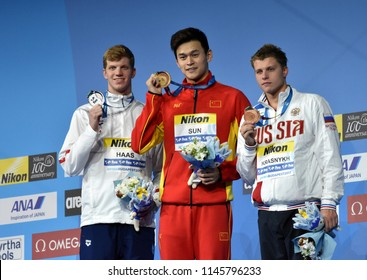 Budapest, Hungary - Jul 25, 2017. HAAS Townley (USA, )SUN Yang (CHN) and KRASNYKH Aleksandr (RUS) at the Victory Ceremony of the Men's 200m Freestyle. FINA Swimming World Championship.