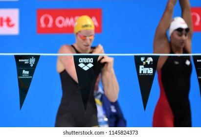 Budapest, Hungary - Jul 25, 2017. arena logo on the backstroke indicator. Emily SEEBOHM (AUS) and MASSE Kylie Jacqueline (CAN) behind the backstroke indicator. FINA Swimming World Championship.