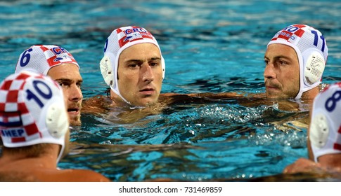 Budapest, Hungary - Jul 25, 2017. Croatia team (BULJUBASIC Ivan in cap 6, JOKOVIC Maro in cap 5, SETKA Andelo in cap 11) before the battle-cry. FINA Waterpolo World Championship was held in Budapest.