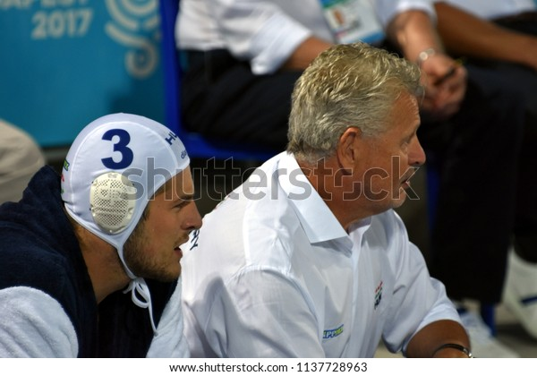 Budapest, Hungary - Jul 25, 2017. GERENDAS Gyorgy coach of Hungary Men Waterpolo team with MANHERCZ Krisztian (HUN). FINA Waterpolo World Championship was held in Alfred Hajos Swimming Centre in 2017.