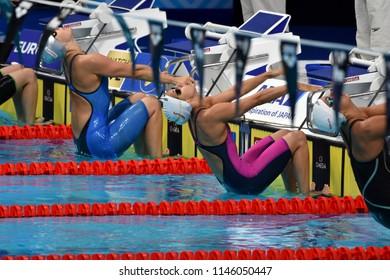 Budapest, Hungary - Jul 26, 2017. Competitive swimmer JOO Sara (HUN) and STEINA Kristina Silvia (LAT) swimming 50m backstroke. FINA Swimming World Championship Preliminary Heats in Duna Arena.